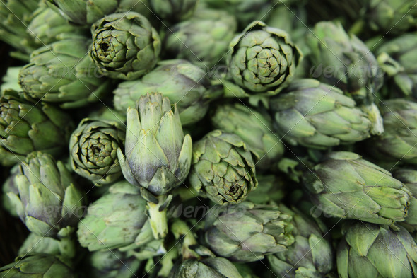 Fresh artichokes at a market - Stock Photo - Images