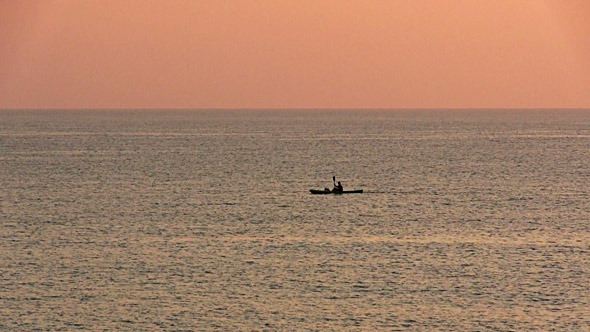 Kayak Floating In The Sea At Dawn