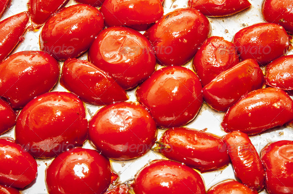 baked tomatoes on a baking tray - Stock Photo - Images