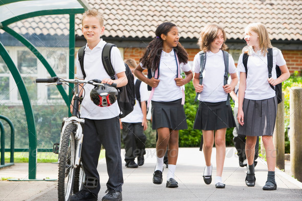 PhotoDune Junior school children leaving school 313768