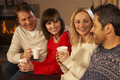 Group Of Middle Aged Couples Sitting On Sofa With Hot Drinks Talking - PhotoDune Item for Sale