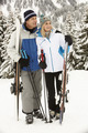 Middle Aged Couple On Ski Holiday In Mountains - PhotoDune Item for Sale