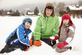 Group Of Children Building Snowman Wearing Woolly Hats - PhotoDune Item for Sale