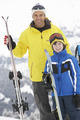 Father And Son On Ski Holiday In Mountains - PhotoDune Item for Sale