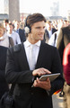 Male commuter in crowd with tablet and headphones - PhotoDune Item for Sale