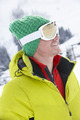Young Man On Ski Holiday In Mountains - PhotoDune Item for Sale