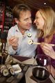 Couple Enjoying Sushi In Restaurant - PhotoDune Item for Sale