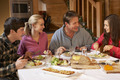 Teenage Family Enjoying Meal In Alpine Chalet Together - PhotoDune Item for Sale