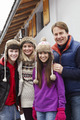 Portrait Of Family Standing Outside Chalet On Ski Holiday - PhotoDune Item for Sale