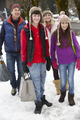 Teenage Family Carrying Shopping Walking Along Snowy Street - PhotoDune Item for Sale