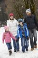 Family Walking Along Snowy Street In Ski Resort - PhotoDune Item for Sale
