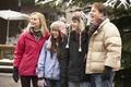 Teenage Family Walking Along Snowy Town Street In Ski Resort - PhotoDune Item for Sale