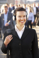 Female commuter in crowd wearing headphones - PhotoDune Item for Sale