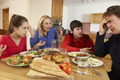 Teenage Family Having Argument Whilst Eating Lunch Together In Kitchen - PhotoDune Item for Sale
