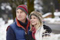 Couple Walking Along Snowy Street In Ski Resort - PhotoDune Item for Sale