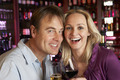 Couple Enjoying Drink Together In Bar - PhotoDune Item for Sale