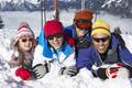 Family Having Fun On Ski Holiday In Mountains - PhotoDune Item for Sale