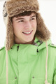 Portrait Of Teenage Boy In Snow Wearing Fur Hat - PhotoDune Item for Sale