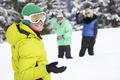 Group Of Young Friends Having Snowball Fight On Ski Holiday In Mountains - PhotoDune Item for Sale