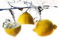 Fresh lemon dropped into water - PhotoDune Item for Sale