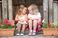 Two Young Girls Playing in Wooden House - PhotoDune Item for Sale