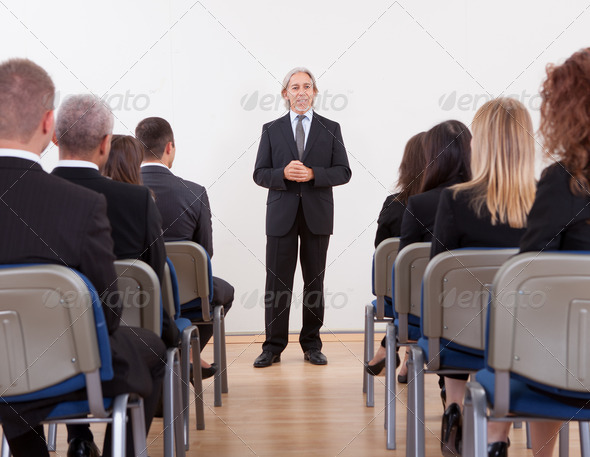 Portrait Of A Senior Manager Giving Presentation - Stock Photo - Images