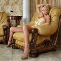 Beautiful woman in underwear in luxury interior.