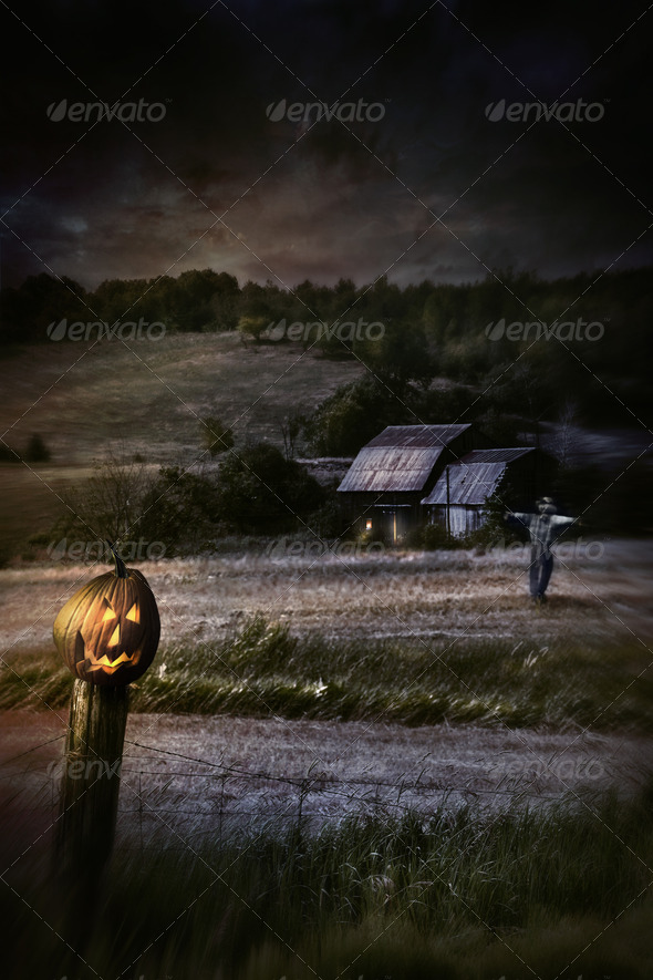 Eerie night scene with Halloween pumpkin on fence - Stock Photo - Images