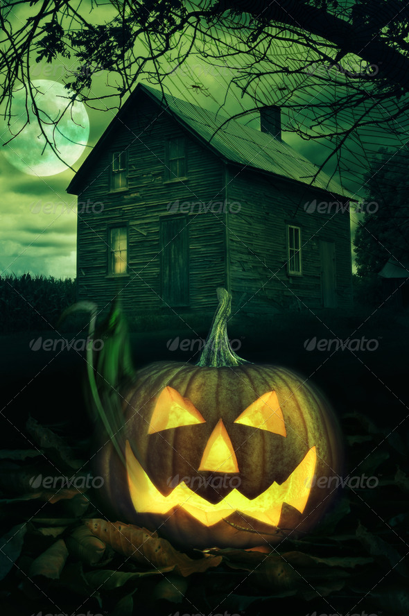 Halloween pumpkin in front of a Spooky house - Stock Photo - Images