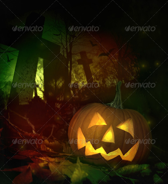 Halloween pumpkin in spooky cemetery - Stock Photo - Images
