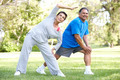 Senior Couple Exercising In Park - PhotoDune Item for Sale