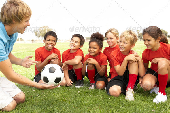 Stock Photo - PhotoDune Young Boys And Girls In Football Team With Coach 318582