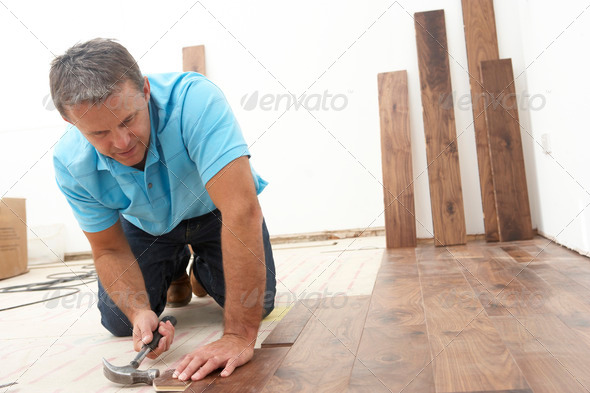 PhotoDune Builder Laying Wooden Flooring 319183