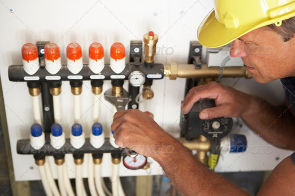 PhotoDune Plumber Working On Pipework In New Home 320218