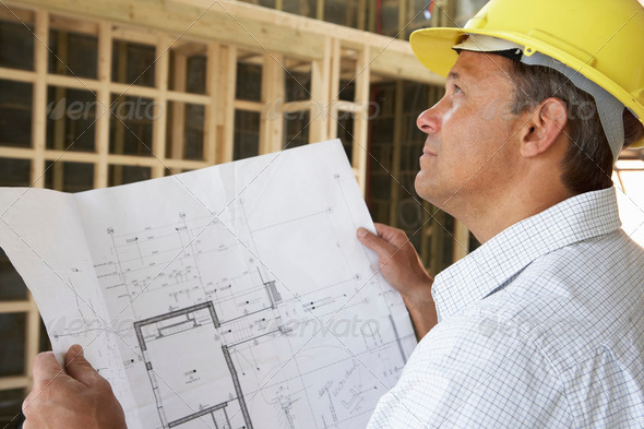 PhotoDune Architect With Plans In New Home 320330