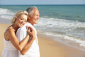 Senior Couple Enjoying Beach Holiday - PhotoDune Item for Sale