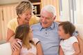 Grandparents laughing with grandchildren