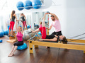 Pilates aerobic personal trainer man in cadillac