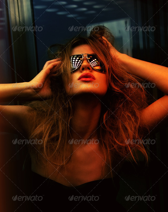 fashionable woman in nightclub - Stock Photo - Images