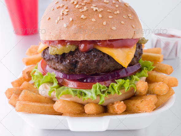 Stock Photo - PhotoDune Cheese Burger In A Sesame Seed Bun With Fries 321698