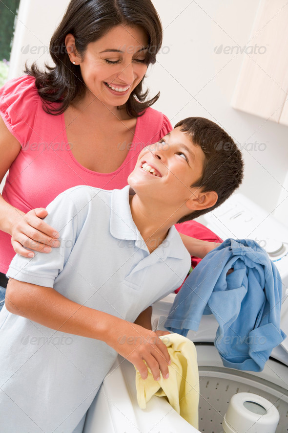 Mother And Son Doing Laundry - Stock Photo - Images