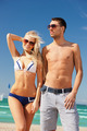 happy couple in sunglasses on the beach - PhotoDune Item for Sale