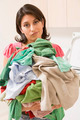 Woman Holding Pile Of Laundry - PhotoDune Item for Sale
