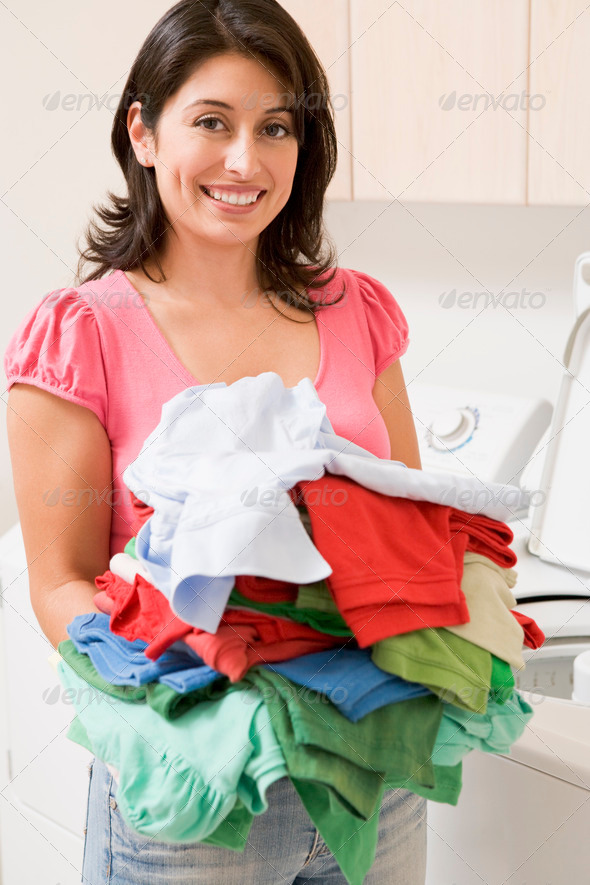 Woman Doing Laundry - Stock Photo - Images