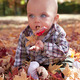 Blue eyed baby playing in autumn leaves - PhotoDune Item for Sale