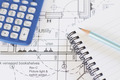 Calculator, Notepad And Pencil Arranged On House Plans - PhotoDune Item for Sale