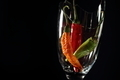Chillies in a broken glass isolated on black - PhotoDune Item for Sale