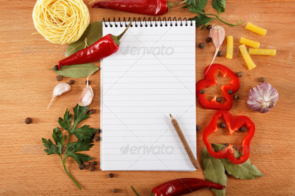 PhotoDune notebook for recipes vegetables and spices on wooden table 3162007
