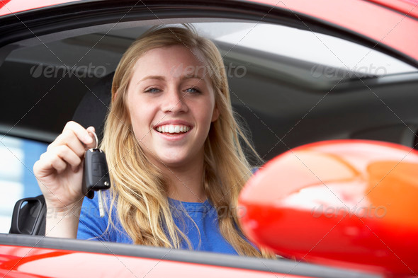 Teenage Girl Sitting In Car, Holding Car Keys And Smiling At The Camera - Stock Photo - Images