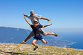happy man and boy jumping on a background of mountains and sky a - PhotoDune Item for Sale
